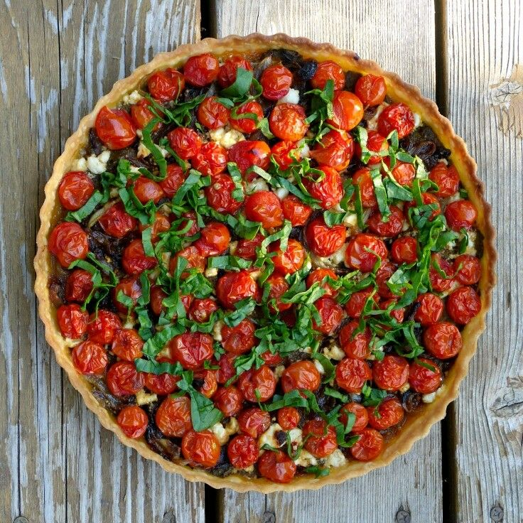 Feta, caramelized onions, and grape-leaf walnut pesto create a savory bed for fresh cherry tomatoes in this beautiful Cherry Tomato Tart. - Little Oven Annie's Cherry Tomato Tart | The Good Hearted Woman