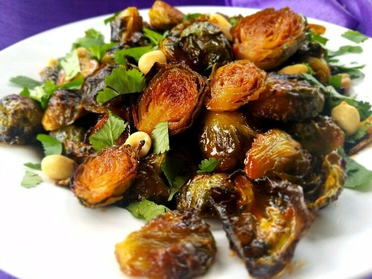 Crispy, tender, spicy, sweet, and addictive are just a few of the adjective that describe these amazing Roasted Gochujang Brussels Sprouts with Cilantro & Peanuts. | The Good Hearted Woman